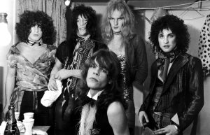 Influential American glam rock band the New York Dolls in their dressing room, 30th October 1972. Standing, left to right: Jerry Nolan, Johnny Thunders, Killer Kane and Sylvain Sylvain. Seated: singer David Johannson. (Photo by P. Felix/Daily Express/Hulton Archive/Getty Images)